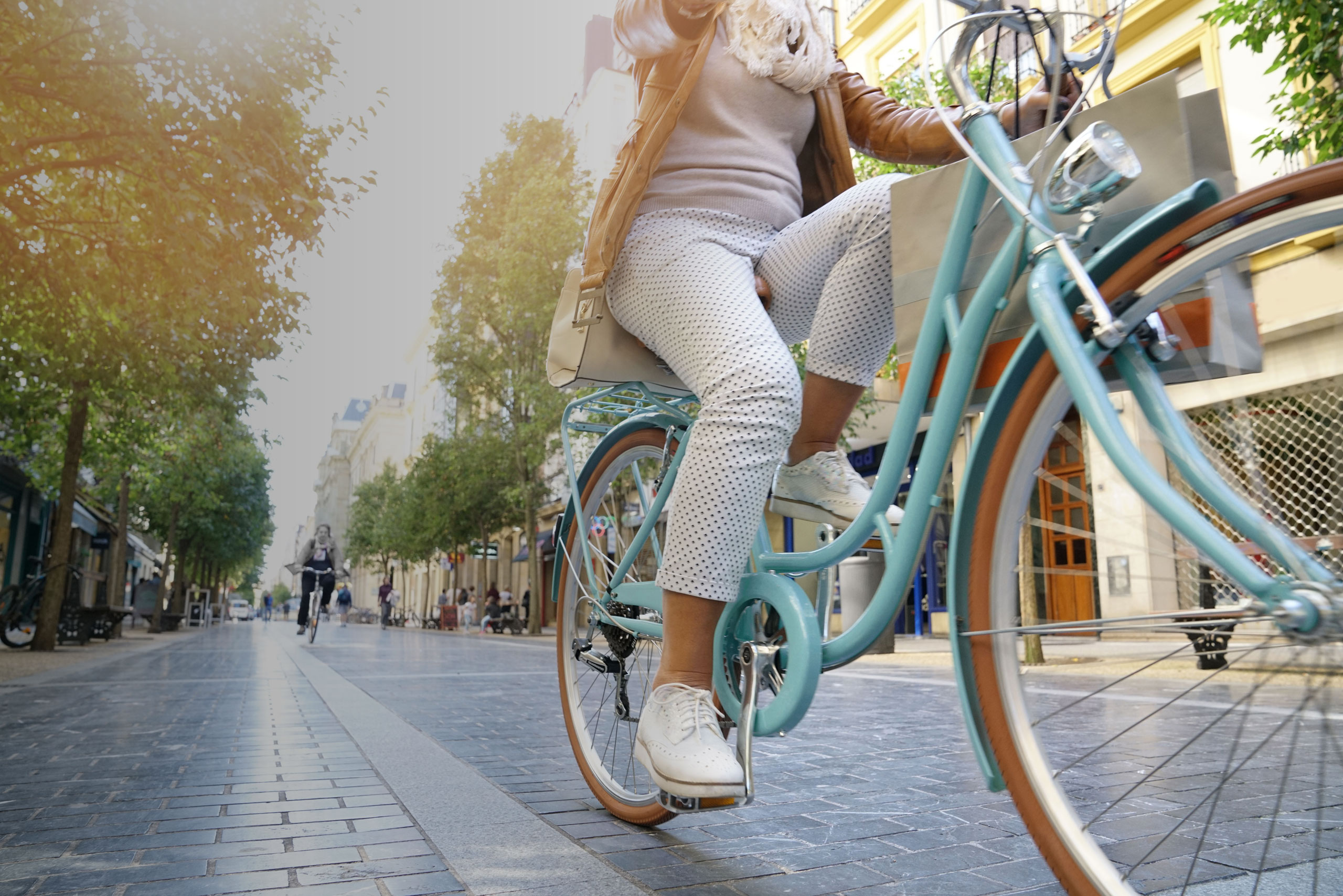 woman with lymphedema riding bike
